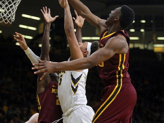 Iowa's Cordell Pemsl takes a contested shot during