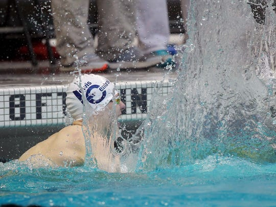 Lewis Central's Jackson Allmon celebrates his win in the 200-yard freestyle during the Iowa high school boys' state swimming meet at the Campus Recreation and Wellness Center in Iowa City on Saturday, Feb. 10, 2018.