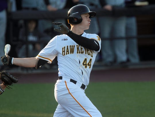 Iowa's Robert Neustrom takes a swing during the Hawkeyes'