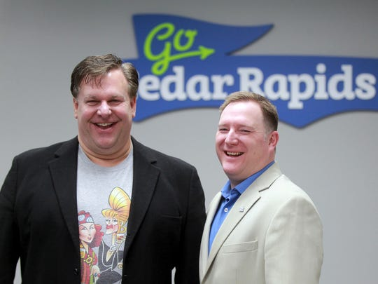 Scott Tallman, director of community events of GO Cedar Rapids, and Aaron McCreight, president and CEO of GO Cedar Rapids, pose for a photo at their office on Monday, Feb. 12, 2018.