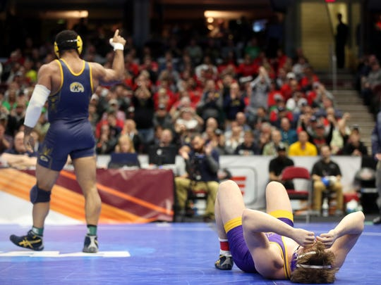 UNI's Jacob Holschlag lies on the mat after getting pinned by Kent State's Kyle Conel at 197 pounds at the NCAA Wrestling Championships at Quicken Loans Arena in Cleveland, Ohio on Saturday, March 17, 2018. Holschlag was pinned in 2:48.
