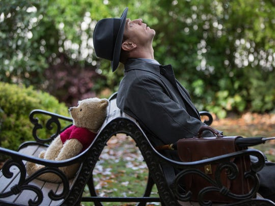 "A grown-up Christopher Robin (Ewan McGregor) reconnects with his longtime friend Winnie the Pooh in ""Christopher Robin."""