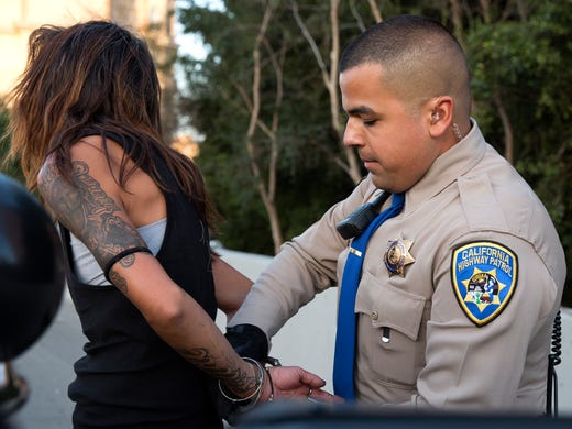 Highway Patrol Officer Benjamin Gomez detains a transit