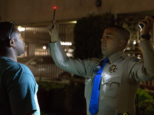 Highway Patrol Officer Benjamin Gomez conducts a sobriety