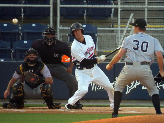Brodie Greene of the Pensacola Blue Wahoos connects on this pitch by Andrew Heaney of the Jacksonville Suns in early game action Saturday afternoon