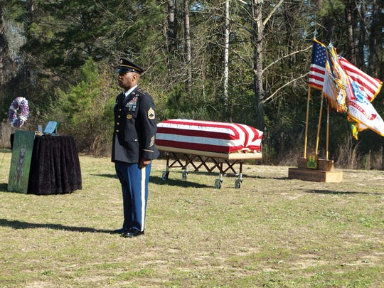 Sgt. 1st Class Gregory Jones performs the roll call during Military Working Dog Cpl. Max's memorial.