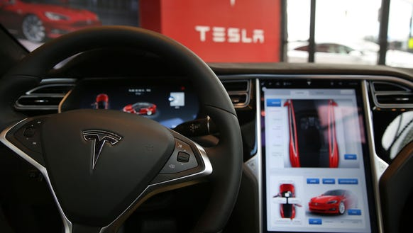 The inside of a Tesla vehicle in a new Tesla showroom and service center in Red Hook, Brooklyn, on July 5, 2016, in New York City. The electric-car company and its CEO and founder Elon Musk have come under increasing scrutiny following a crash of one of its electric cars while using the controversial Autopilot service.