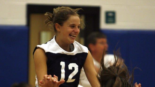 Pelham's Christina Schirone, center, celebrates with her teammates after they beat Ardsley  at Pelham High School Sept. 26, 2006. Pelham won 3-2.( Rory Glaeseman / The Journal News )