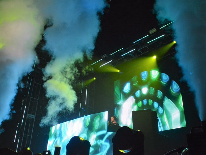 Rising smoke and glowing neon lights create a mystic