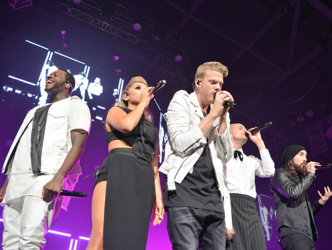 "The Capella group ""Pentatonix"" smiles and sings to"