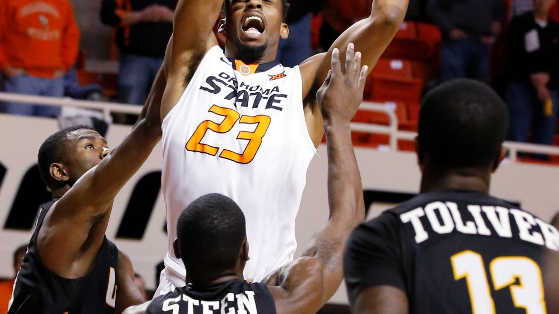 3bf9df6eb82 STILLWATER, Okla. (AP) — Oklahoma State took care of business to set up  Saturday's showdown with Wichita State. Jeffrey Carroll scored 18 points  and Leyton ...