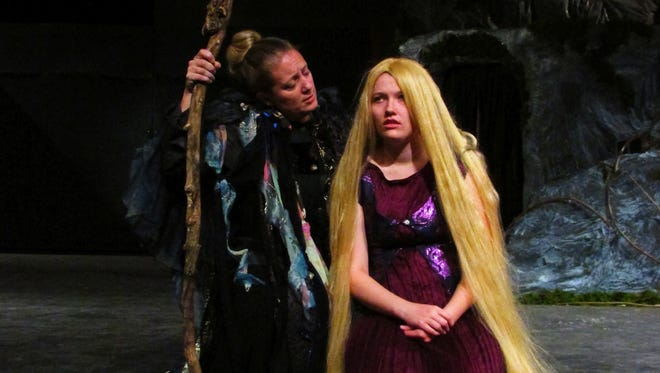 Deanne Stokes, left, rehearses her role at the Witch for UW-Manitowoc Theatre's 'Into the Woods' with Ariel Ducat, who plays Rapunzel.