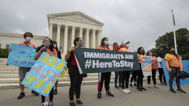 In this June 18  photo, Deferred Action for Childhood Arrivals students celebrate in front of the Supreme Court after the Supreme Court rejected President Donald Trump's effort to end legal protections for young immigrants in Washington.