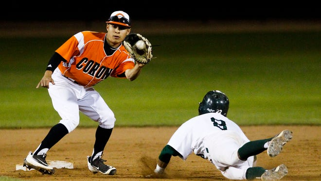 Horizon's Kobie Tinsley slides into second base as Corona Del Sol's Josh Cuellar prepares to tag as Horizon High School faces off against Corona Del Sol High School on Tuesday, March 15, 2016, at Horizon High School in Scottsdale, Ariz. Tinsley was called out on the play.