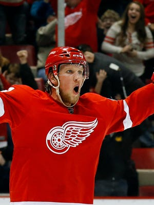 Red Wings forward Justin Abdelkader celebrates after scoring against the St. Blues in overtime in Detroit on March 22, 2015.