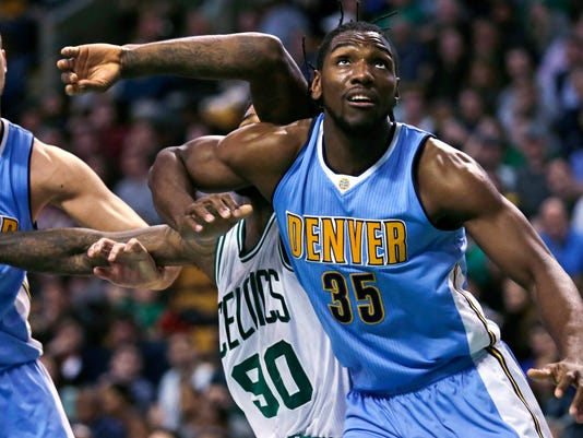 Denver Nuggets forward Kenneth Faried (35) blocks out Boston Celtics forward Amir Johnson (90) on a rebound during the second quarter of an NBA basketball game in Boston, Wednesday, Jan. 27, 2016.  At left is Nuggets forward Danilo Gallinari. (AP Photo/Charles Krupa)