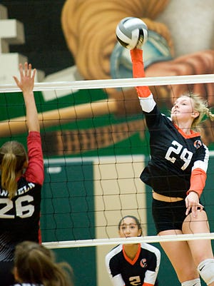 Marlington's Maggie Fellers (29) spikes the ball against Canfield in a tournament match in October 2019.