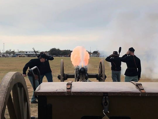 Re-enactors fire their cannon Saturday, Dec. 2, 2017,