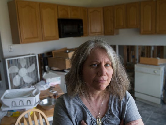 Lacey resident Laurie Fox inside her Sandy-damaged