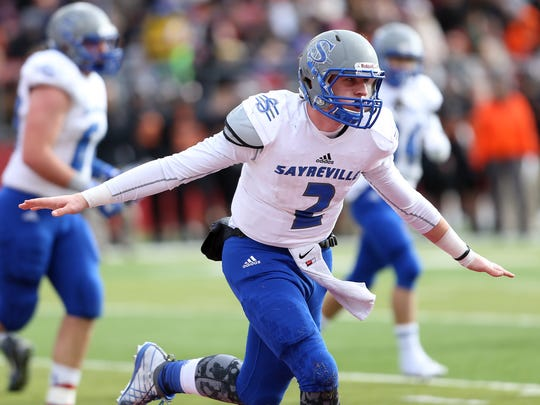 Sayreville quarterback Jayson DeMild celebrates after his first half keeper for a touchdown vs. Middletown North in North 2 Group IV sectional football championship at Rutgers University's High Point Solutions Stadium.