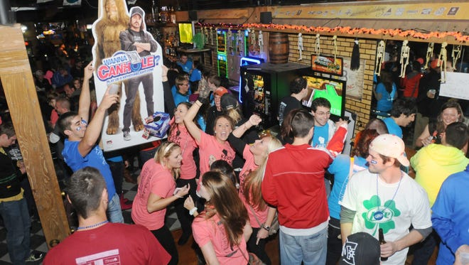 Pub crawlers crowd the dance floor at Barley & Hops during the Oshkosh Pub Crawl in this October 2012 file photo.