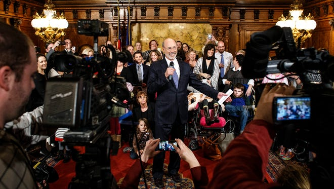 Pennsylvania Gov. Tom Wolf meets with medical marijuana advocates in March. Wolf supports medical marijuana and is encouraging lawmakers to pass medical marijuana legislation.
