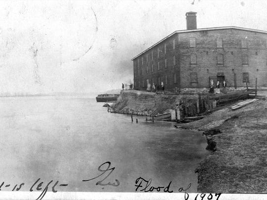 The Petersburg Distillery, shown here during the 1907 flood, will be commemorated with a historical marker on June 4.