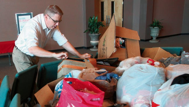 Harvest Christian Center associate pastor John Absher arranged donations last year at the center to be donated to Sharefest. This year's event is set for Oct. 24 at the El Paso County Coliseum