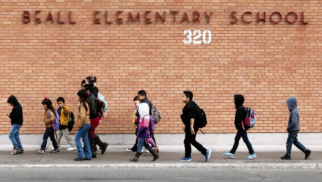 Beall Elementary School students leave the campus at the end of a school day at 320 N. Piedras St. The Texas Supreme Court on Friday declared the state's $40 billion school-finance system constitutional.