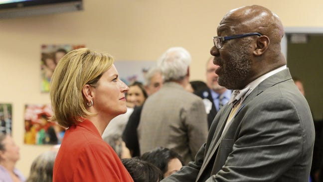 Dori Fenenbock shares a moment with Texas Commissioner of Education Michael L. Williams in May before she was sworn in as an EPISD trustee.