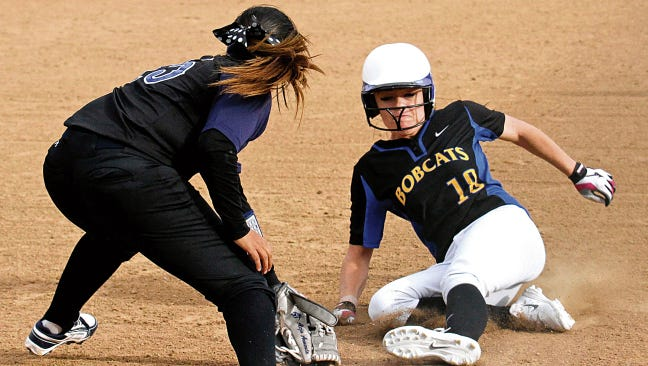 Bloomfield's Daysha Smith slides safely into third base during a March 19 game against Piedra Vista at the Farmington Sports Complex in Farmington.
