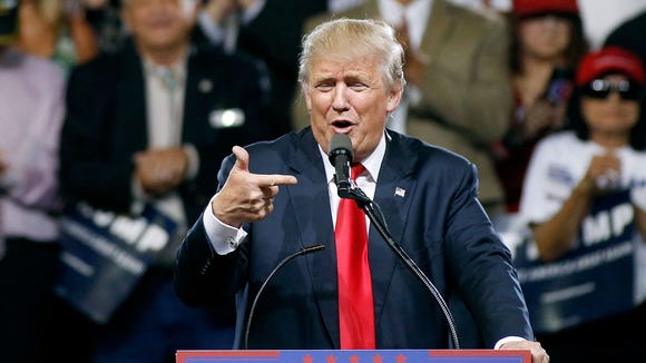 Donald Trump speaks to a crowd of supporters during