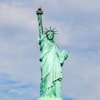 Foreign governments are issuing warnings to their citizens about travel to the U.S., including gun violence, police shootings and the zika virus. The Statue of Liberty is a popular New York City tourist destination.