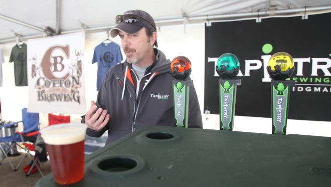 Greg Korson, brewer and co-owner of Tapistry Brewing, discusses the creation of Gordgantuan, a pumpkin spiced ale pictured in the foreground.