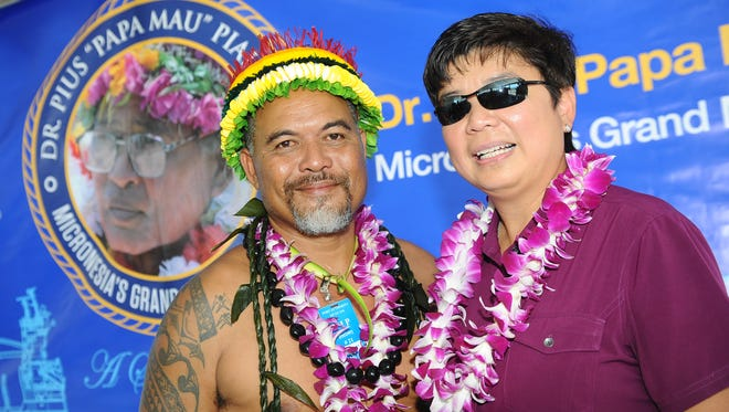 """In this September 2016 file photo, Matson General Manager Bernie Valencia, right, stands with Larry Raigetal during a vessel naming ceremony at the Port Authority of Guam. The ship, """"Papa Mau,"""" was named after the late traditional navigator Pius """"Papa Mau"""" Piailug who is sometimes referred as """"Micronesia's grand master navigator."""" Raigetal said he is the nephew of Piailug."""