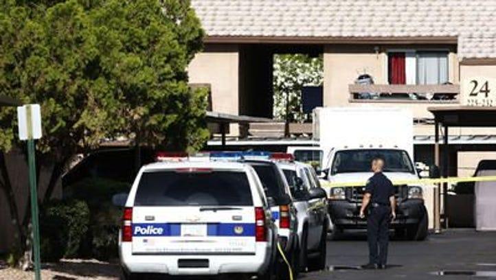 FBI agents search a Phoenix apartment on on Monday,