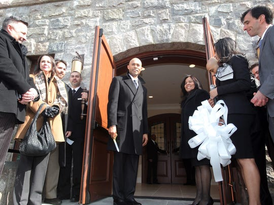 Former Yankees star Mariano Rivera and his wife, Clara Rivera, open the doors to Refuge of Hope Church during a ribbon cutting ceremony in New Rochelle March 6, 2014. Rivera renovated a rundown church building to serve as the Christian Pentacostal congregation's home. Clara Rivera leads the ministry.