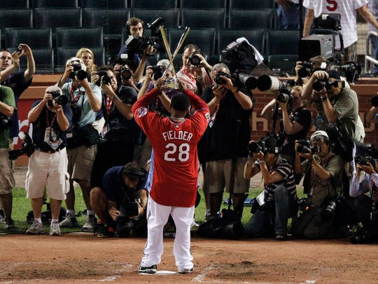 Prince Fielder of the Milwaukee Brewers holds up his championship trophy after winning the MLB baseball Home Run Derby in St. Louis, Monday, July 13, 2009.