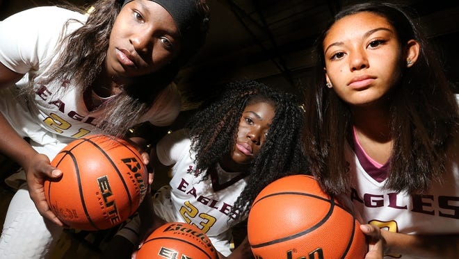 Meleah Morgan, left, Alexis Singleton and Jordan Pinson of the Andress Eagles.