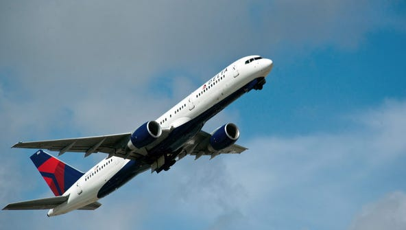 A Delta Airlines jet takes off Feb. 21, 2013, from