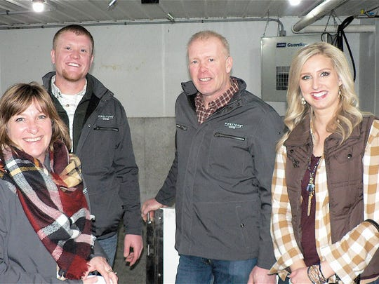 Dan and Kendra Helvig (top left &  bottom right) with Dan's parents Jon and Karen Helvig, feed out 15,000 hogs twice a year at their Minnesota farm.