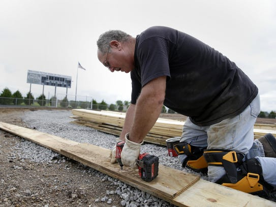Pat Smith works on a radius board that will run along