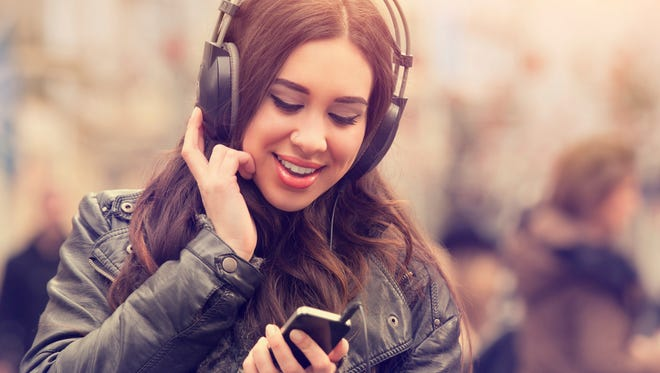 Urban girl listening to some music.