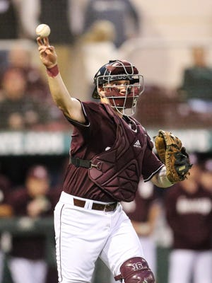 Mississippi State's Josh Lovelady (16) makes a throw to first base. Mississippi State played Texas Tech in the 2017 baseball season-opener on Friday, February 17 at Dudy Noble Field in Starkville. Photo by Keith Warren