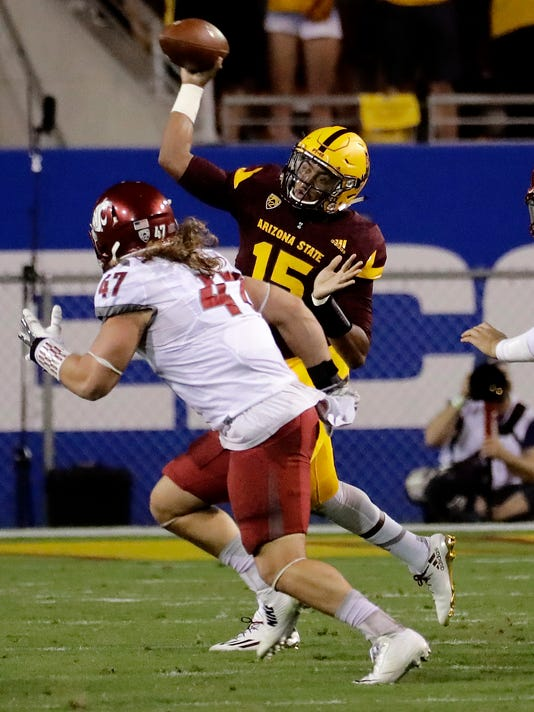 Arizona State quarterback Dillon Sterling-Cole (15) throws over Washington State linebacker Peyton Pelluer (47) during the first half of an NCAA college football game, Saturday, Oct. 22, 2016, in Tempe, Ariz. (AP Photo/Matt York)