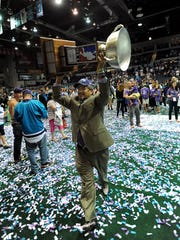 Rochester's owner Curt Styres carries the 2014 NLL championship trophy following Knighthawks' third straight title, a league first.