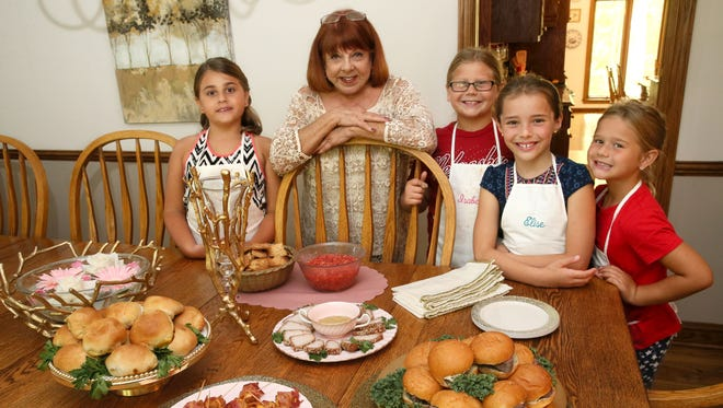Marji Horvat recently held a cooking class for (from left) Fiona Glorioso 8, Isabella Pitre. 10, Elise Schuman, 8 and Elaina Pitre, 8. Dishes include (from left) curry beef buns, bacon cheese roll-ups, Chinese pork tenderloin (center) with hot mustard sauce, strawberry fruit salsa with cinnamon sugar pita chips and beef tenderloin sandwiches (far right).