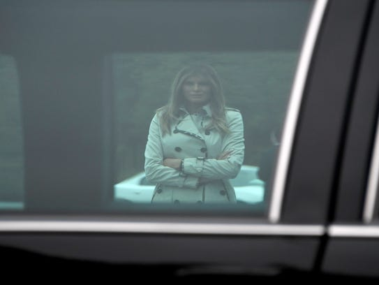 First lady Melania Trump is framed through the window