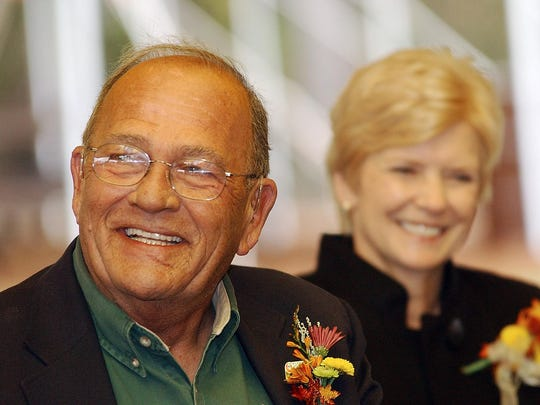 Jim Gaston, left, and wife Jill Gaston, smile during the dedication ceremony for the James A Gaston Visitor Center in Bull Shoals on Oct. 19, 2006.