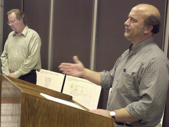 Jim Rosenberg, right, and Craig Knapp address the small crowd gathered at the Wausau Municipal Airport in this October 2003 file photo.